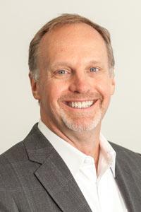 Scott Brennan president di RoomIt by CWT